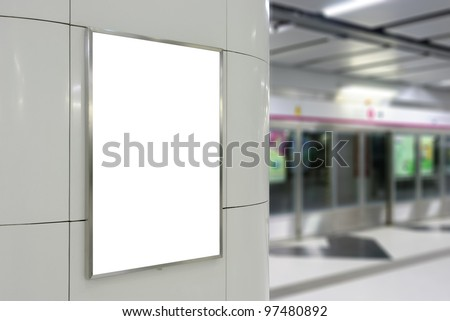 Blank big vertical / portrait orientation billboard on modern white wall with platform background - stock photo