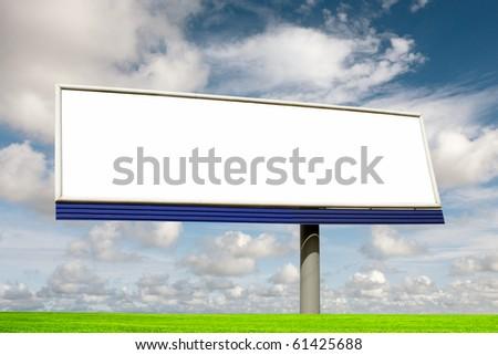 Blank bilboard in a green field - stock photo