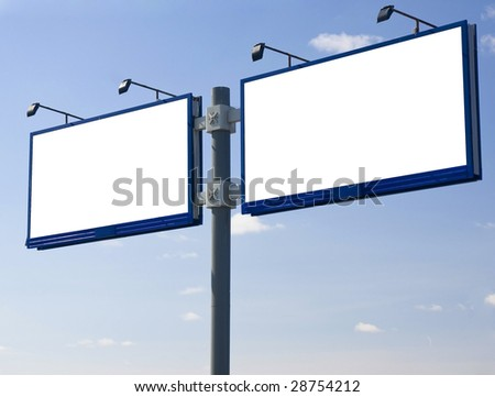 Blank billboard  against a blue sky. - stock photo