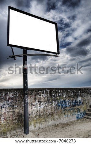 blank billboard against a blue sky. just add your text. - stock photo