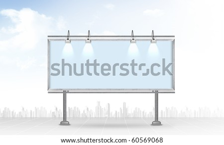 Blank billboard against a city background - stock photo