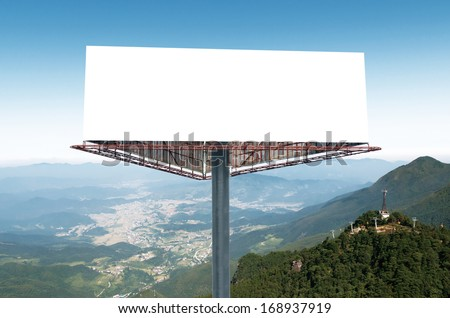 Blank billboard against blue sky, put your own text here