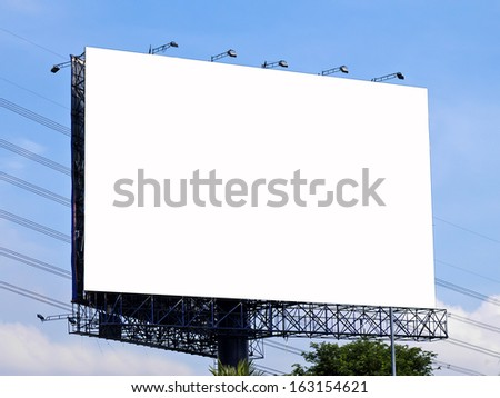Blank billboard against blue sky with clouds. Useful for your advertisement.  - stock photo