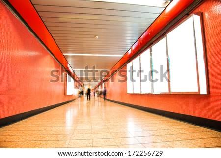 Blank billboard at an underground passage. - stock photo