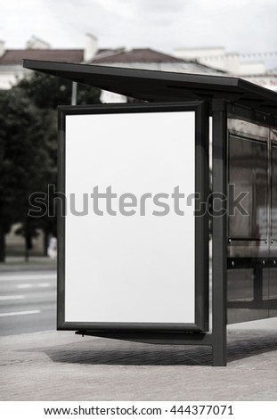 Blank billboard at the bus stop. Street blank poster. Isolated with clipping path. Selective focus. - stock photo