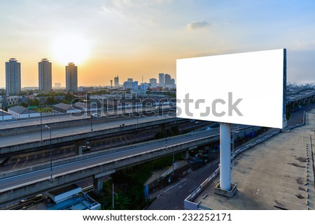 Blank billboard at twilight for advertisement. - stock photo