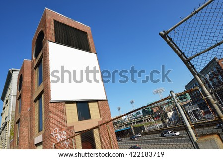 Blank billboard canvas on brick wall. Outdoor advertising in the city.  - stock photo