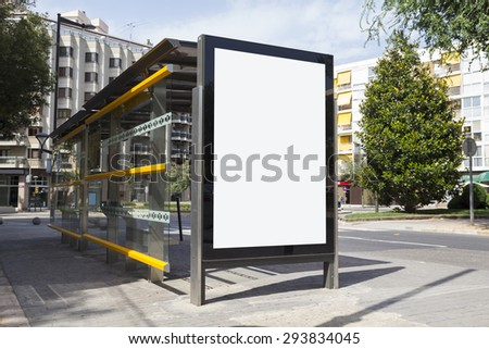 Blank billboard for advertisement, in a bus stop at the street - stock photo