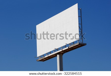 Blank billboard for new advertisement with blue sky background - stock photo