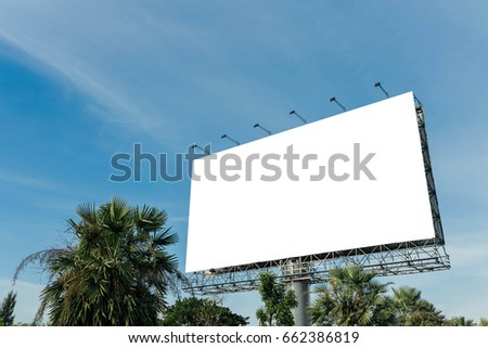 Blank billboard for new advertisement with blue sky background.