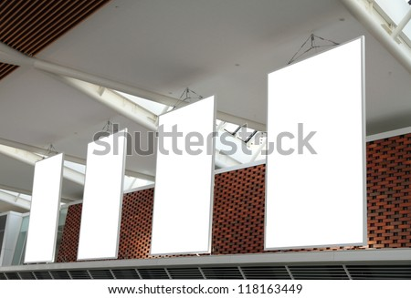 Blank billboard hanging from airport ceiling - stock photo