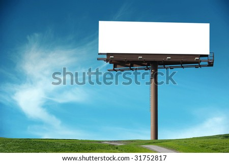 Blank billboard in a field with a blue sky - stock photo