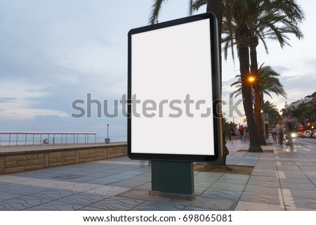 Blank billboard in a footpath, next to the sea