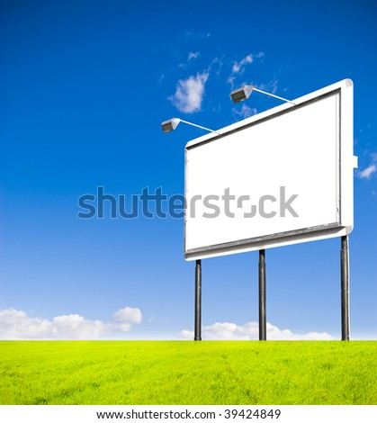 Blank Billboard in a green field. You can fill it with your text