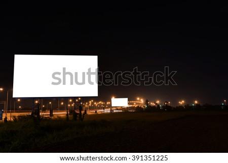 blank billboard in dark night. - stock photo