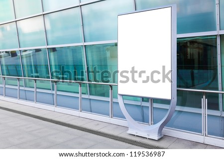 Blank billboard in front of modern building in a city. Put your advertising here,