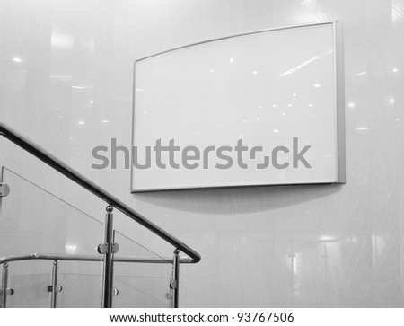 Blank billboard in mall and reflections on wall - stock photo