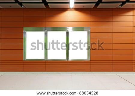 Blank billboard in metro station - stock photo