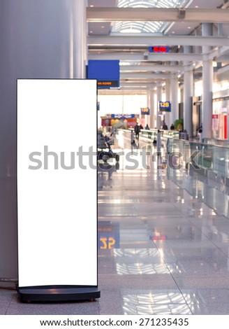 Blank billboard in modern interior hall at airport. - stock photo
