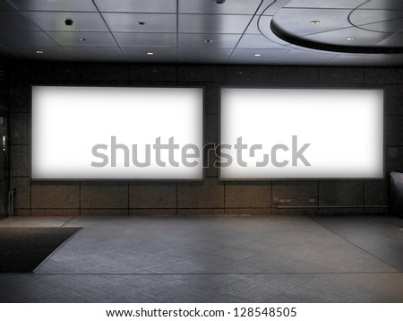 blank billboard in public trainstation hall - stock photo