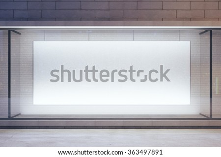 Blank billboard in showcase on evening street, mock up - stock photo