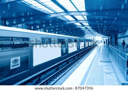 blank billboard in subway station - stock photo