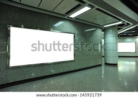 Blank billboard in subway underground passage - stock photo