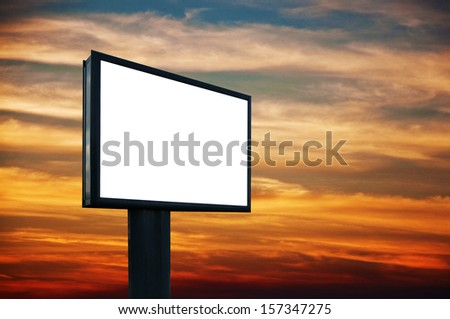 Blank billboard in sunset, outdoor advertising concept.