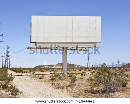 Blank billboard in the middle of the Mojave desert. - stock photo