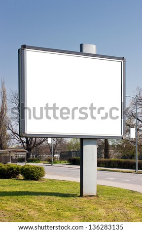 Blank billboard in the street in spring
