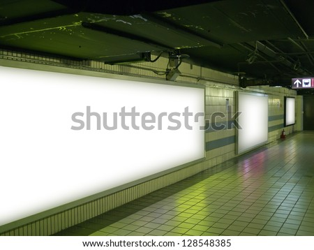 blank billboard in underground hall public space - stock photo