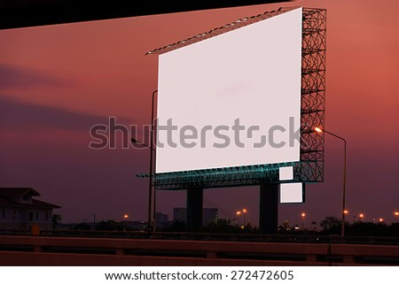 blank billboard is between skytrain railroad and expressway  this Car Lights in twilight time. - stock photo