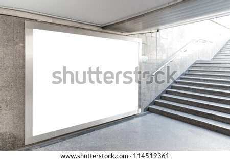 Blank billboard located in underground hall. Useful for your advertising. - stock photo