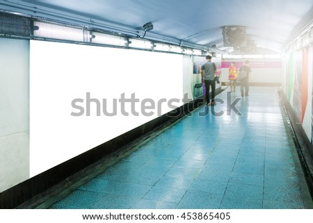 Blank billboard mocup or poster located in underground hall,Business billboard for advertising,People motion blur - stock photo