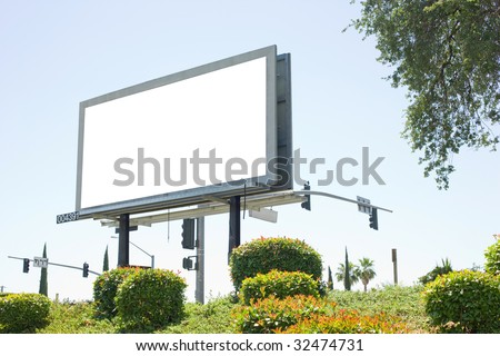 Blank billboard off the side of a freeway - stock photo