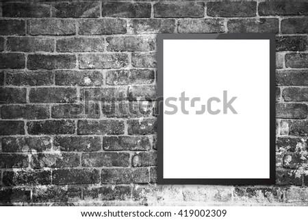 Blank billboard on a brick wall. - stock photo