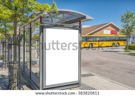 blank billboard on a bus shelter mockup with space to place your own advertising - stock photo