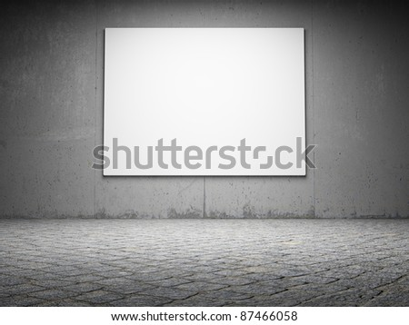 Blank billboard on a grungy concrete wall at night