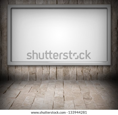 Blank billboard on a stone wall - stock photo
