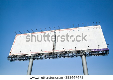 Blank billboard on blue sky for your advertisement - stock photo