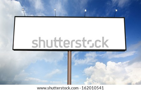 Blank billboard on blue sky with sun rays for your advertisement - stock photo