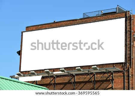 Blank billboard on brick wall, banner edge and grommets preserved for a more realistic look - stock photo