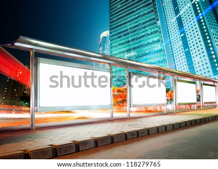 Blank billboard on bus stop at night - stock photo