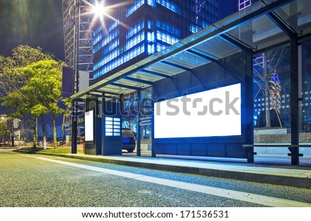 Blank billboard on bus stop at night