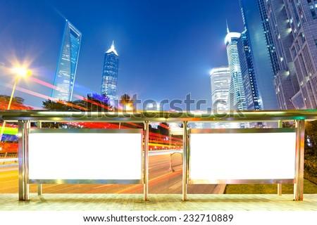 Blank billboard on bus stop at night - stock photo