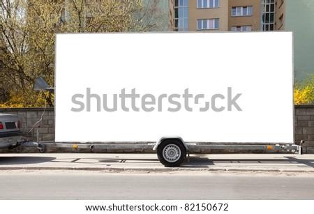 Blank billboard on car trailer - stock photo