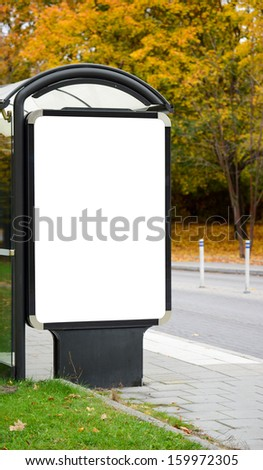 Blank billboard on city bus station - stock photo