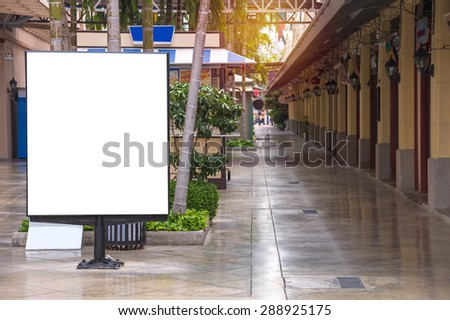Blank Billboard on City Street for new advertisement. - stock photo