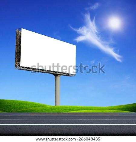 Blank billboard on road - stock photo