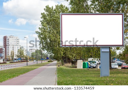 Blank billboard on road in city - stock photo